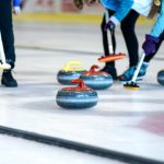 Curling stones and brooms