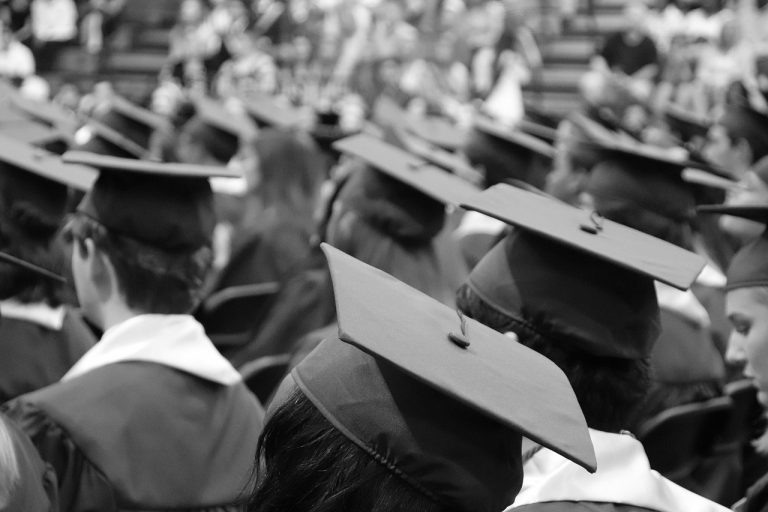 Group of graduates wearing caps and gowns