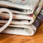 Newspapers and mug of tea