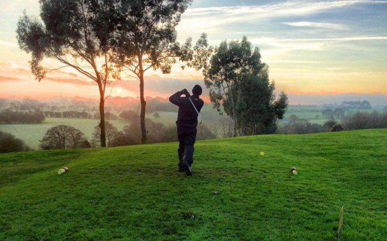 Golfer swinging club